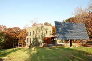 Passive House in the Woods southeast perspective with solar tracker