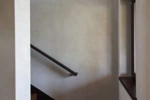 Passive House in the Woods, earthen plaster and handrail