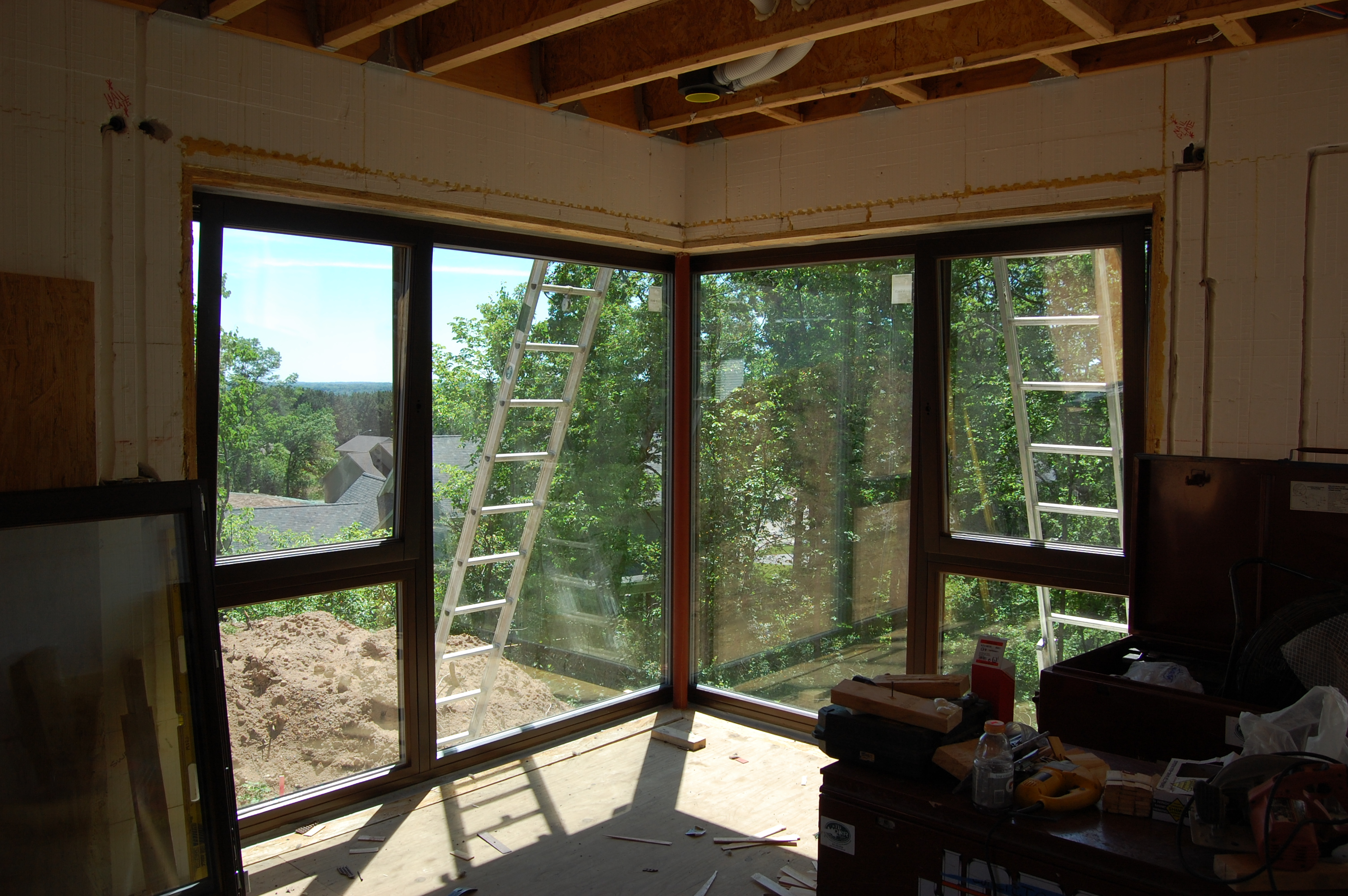 passive house in the woods living room corner window