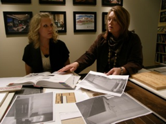 Erin and Christine presenting cabinetry details
