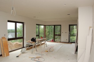 Passive House in the Woods living room with sheet rock