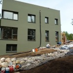Passive House in the Woods south facade and rain garden