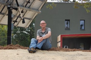 Tim Eian in front of the Passive House in the Woods